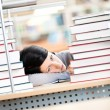 Young female sleeping at the desk - Stock Photo