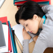 Attractive female sleeping at the desk — Stock Photo #24074775