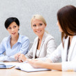 Female colleagues review business plan — Stock Photo