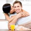 Girl kisses eating boyfriend — Stock Photo #24075751