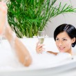 Girl taking a bath drinks sparkling wine — Stock Photo #24075807