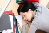 Attractive female sleeping at the desk — Stock Photo