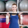 Athlete woman working out with gymnastic stick — Stock Photo