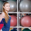Sportswoman works out with gymnastic stick — Stock Photo