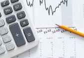 Close up shot of calculator, graphs, pencil — Stock Photo