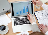 Business discussing graphs — Stock Photo