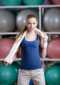 Portrait of a sportive young sportive woman with towel — Stock Photo