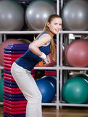 Woman works out with gymnastic stick — Stock Photo