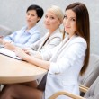 Female colleagues discuss business plan sitting at the meeting hall. — Stock Photo #24410413