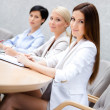 Female colleagues discuss business plan sitting at the meeting hall. - Stock Photo