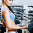 Sportive girl with dumbbells — 图库照片