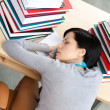 Beautiful student sleeping at the desk — Stock Photo