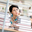 Sad female student over the books — Stock Photo