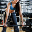 Sportswoman with dumbbells — Stock Photo