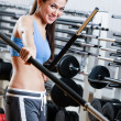 Royalty-Free Stock Photo: Athletic woman with dumbbells stick