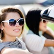 Close up of girls in sunglasses in the convertible car - Stock Photo