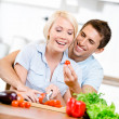 Couple cooking breakfast together — Stock Photo #24411793