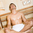 Royalty-Free Stock Photo: Half-naked male relaxing in asana in sauna