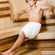 Half-naked male relaxing in sauna — Stock Photo #24412063
