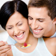 Close-up of man feeding his girlfriend — Stock Photo