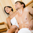 Royalty-Free Stock Photo: Half-naked man and lady relaxing in sauna