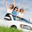 Friends stand in the white car with hands up — Stock Photo