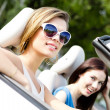 Постер, плакат: Two girls ride the cabriolet