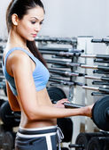 Sportive girl with dumbbells — Stock Photo
