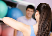 Coach shows exercises to group of — Stock Photo