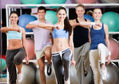 Group of athletic at the gym — Stock Photo
