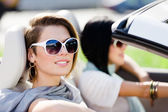 Close up of girls in sunglasses in the convertible car — Stock Photo