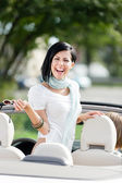 Lovely teenager stands in the cabriolet — Stock Photo