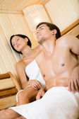 Half-naked man and lady relaxing in sauna — Stock Photo