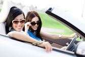 Two happy friends drive the car — Stock Photo