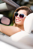 Portrait of pretty woman in the white car — Stock Photo