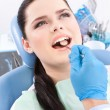 Dentist is looking for the defects in the oral cavity of the patient — Stock Photo