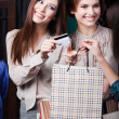 Girls pay with credit card — Stock Photo