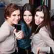 Girls photo session on the mobile phone after shopping — Stock Photo #24559593
