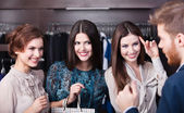 Three wonderful women talk with salesperson — Stock Photo