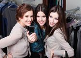 Girls photo session on the mobile phone after shopping — Stock Photo