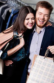 Lolling couple is in the shop — Stock Photo