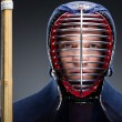 Portrait of kendo fighter with shinai — Stock Photo #24684153