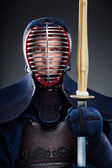 Kendo fighter with wooden sword — Stock Photo
