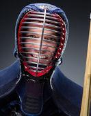 Portrait of kendoka with shinai — Stock Photo