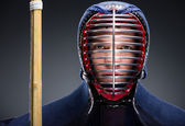 Portrait of kendo fighter with shinai — Stock Photo
