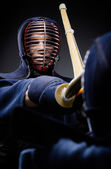Close up of competition of two kendo fighters — Stock Photo