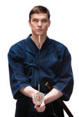 Kendoka in hakama keeps bokken — Stock Photo