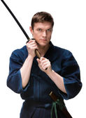 Kendoka in hakama training with bokken — Stock Photo