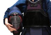 Close up of kendo men in hands of kendoka — Stock Photo