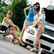Group of women near the broken car on the road — Stock Photo